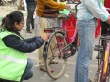 A volunteer sticks tapes on a bicycle