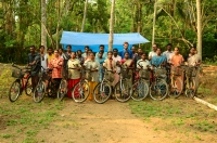 Researchers and workers with their cycles at the excavation site of Muziris project